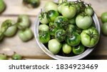 Green Tomatoes In A Bowl On A...