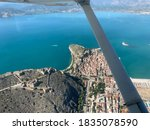 Aerial photograph of Nafplion the first capital of modern greece. Castle, city centre and sea
