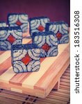 Small photo of Vintage picture. Sushi and rolls on a bamboo geta