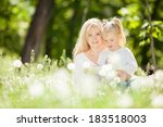 mother with daughter in the park | Shutterstock . vector #183518003