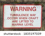 Warning Sign In White With Red...