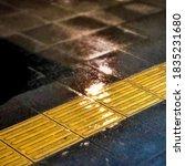 Wet Sidewalks In The Heart Of...