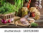 Rural smokehouse ham preparation for smoking - stock photo