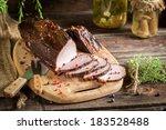 Closeup of freshly smoked ham in a rural smokehouse - stock photo
