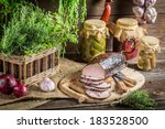 Pantry with preserves and smoked ham - stock photo