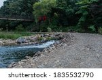 River Flowing Through Culvert...