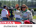 Birmingham Alabama USA - April 10, 2011: 78 Simona de Silvestro, Switzerland, HVM Racing. Waves at fans during introductions before Indycar race.  - stock photo
