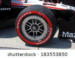 Birmingham Alabama USA - April 10, 2011: Firestone Racing tire, official tire of Indycar. Red sidewall soft compound - stock photo