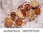 Various Nuts In Wooden Bowls ...