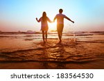 young happy couple running to... | Shutterstock . vector #183564530