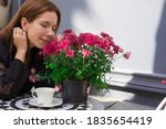 Girl Sitting In A Cafe Near A...