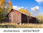 Old Shabby Red Barn In The Fall ...