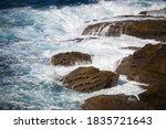 Waves Crashing On Rocks ...