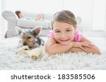little girl lying on rug with... | Shutterstock . vector #183585506