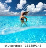 woman splashing water with her... | Shutterstock . vector #183589148