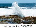 Sea Wave Slamming On The Rocks...