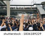 Small photo of Thai protesters showing a three-finger salute as they gather demanding the government to resign and to release detained leaders in Thailand.