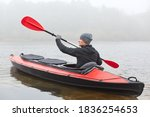 Profile Of Handsome Man Rowing...