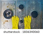 Yellow Gloves On Dirty Stove...