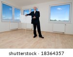 a real estate agent standing... | Shutterstock . vector #18364357