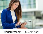 woman using a tablet | Shutterstock . vector #183644759