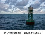 Marine Buoy At Sunset In The...