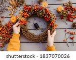 Girl Making Floral Autumn Door...