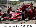 Birmingham Alabama USA - April 10, 2011: Pit stop action as teams change tires and refuel the race cars. 9 Scott Dixon, New Zealand Chip Ganassi Racing Target - stock photo