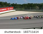 Birmingham Alabama USA - April 10, 2011: Cars dicing for position, wheel to wheel, at the drop of the green flag. - stock photo