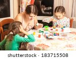 portrait of mother with two... | Shutterstock . vector #183715508