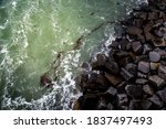 An Ariel Shot Of Waves Breaking ...