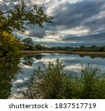 A view across the millpond at Bartley Water at Eling near Southampton, UK in Autumn