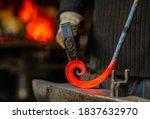 The Blacksmith Twists The...