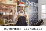 Asian Waitress In Red Santa Hat ...