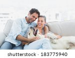 happy couple petting their... | Shutterstock . vector #183775940