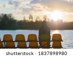 Young Man Sitting Alone On Seat ...