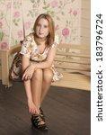 beautiful young woman sitting... | Shutterstock . vector #183796724