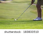 a golfer getting ready to hit... | Shutterstock . vector #183833510