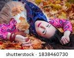 Happy Woman Lies On Autumn...