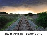 old railway tracks in the light ... | Shutterstock . vector #183848996