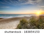 Sunset Over Sand Dunes At...