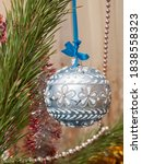 Small photo of Christmas ball with spruce branches and festive chaplet on the background. Christmas and New Year concept.