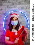 Woman In Medical Mask And Sant...