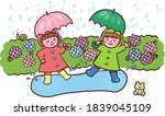 Children Enjoying A Rainy Day