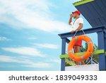 Male Lifeguard On Watch Tower...
