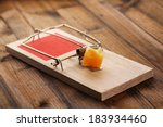 Mousetrap With Cheese On Woode...
