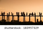 silhouette people crossing the... | Shutterstock . vector #183957329
