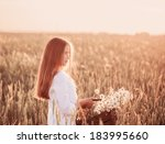 girl in the wheat field with... | Shutterstock . vector #183995660