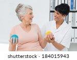 Female Doctor With Senior...