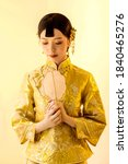 Asian Woman In Traditional...